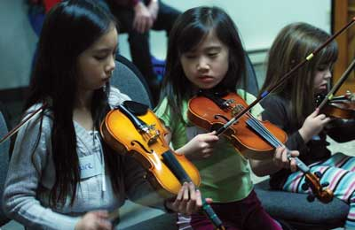 kids playing violin