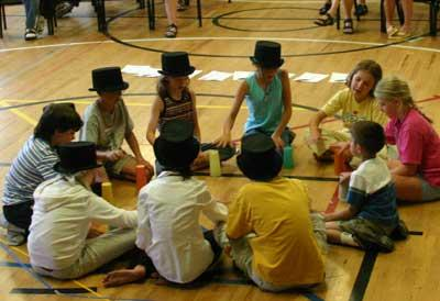 Circle of kids with tophats